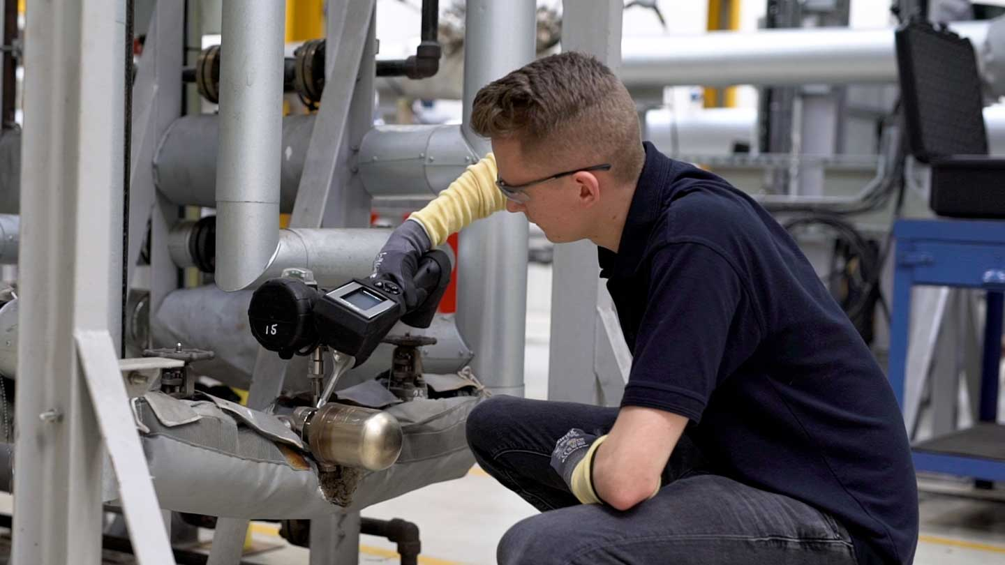 Engineer testing steam trap with STAP Handheld device