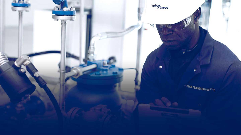 Spirax Sarco engineer inspecting machinery
